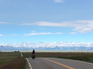 Alma Arteaga pedaling along the Rocky Mountain Front